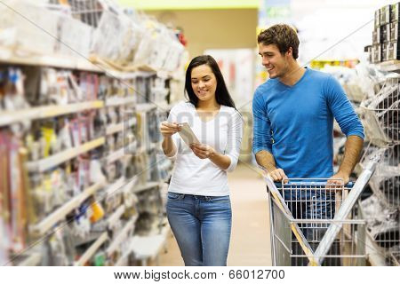 young couple shopping for DIY tools at hardware store