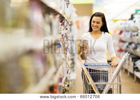 happy female customer shopping in hardware store