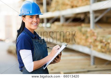 pretty female hardware store worker working in warehouse