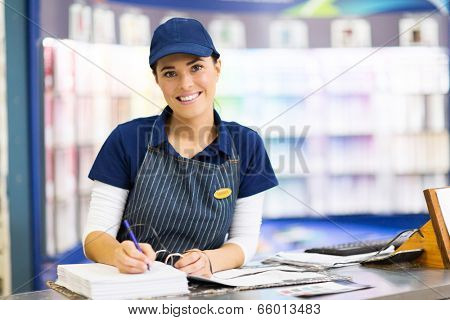 beautiful female paint store clerk working