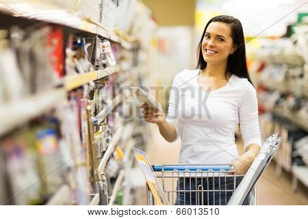 happy young woman shopping at hardware store
