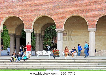 Unknown People Are Resting Near City Hall In Stockholm, Sweden