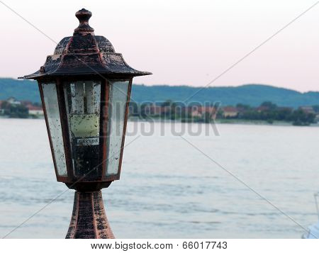 Street Light Closeup With River In Background