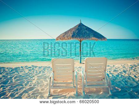 Empty beach chair before oceanwith a retro effect