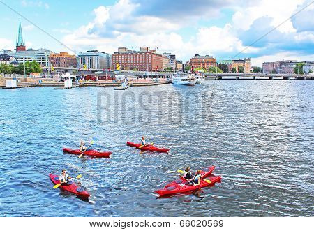 Unknown People Are Boating In Kayaks In Stockholm, Sweden