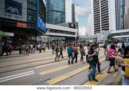 HONG KONG - NOVEMBER 1, 2011: Pedestrians and traffic in Central is the central business district of Hong Kong. It is located in Central and Western District, on the north shore of Hong Kong Island.