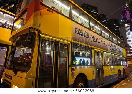 HONG KONG - SEPTEMBER 30, 2011: City double decker bus on the streets of Hong Kong night. Bus mode of transport is very developed and very popular.