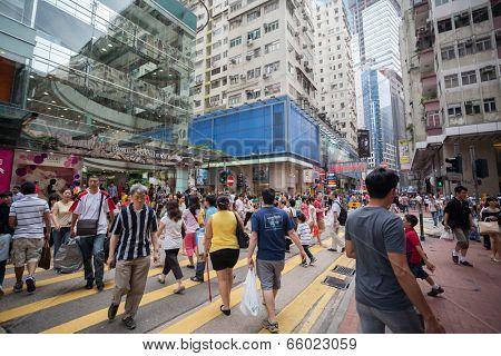 HONG KONG - NOVEMBER 1, 2011: Pedestrians in a crosswalk Causeway Bay district in Hong Kong. Causeway Bay is a heavily built-up area of Hong Kong, located on Hong Kong Island.