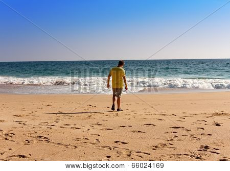 India. Kerala. The teenager on a beach