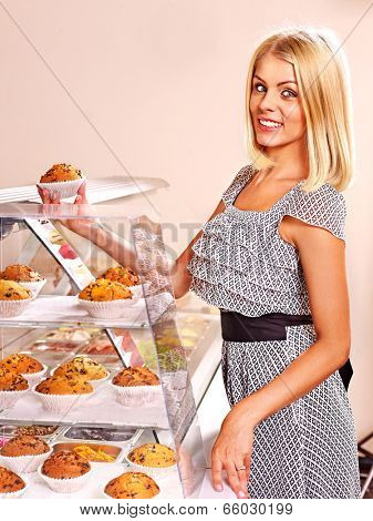 Woman holding  food at cafeteria .