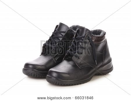 Short black leather boots.