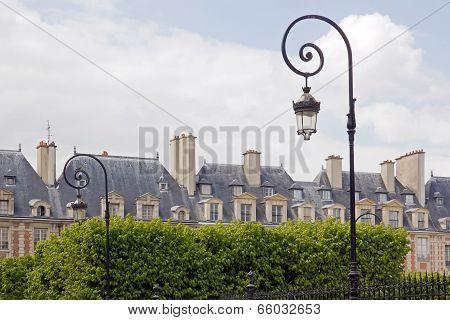Place of Vosges, seen by the public garden Louis XIII (Paris France)