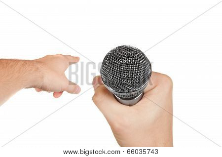 Microphone In A Hand And Other Hand Pointing Forward