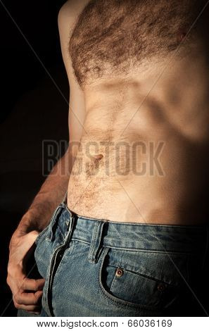 Flat Sporty Male Belly. Closeup Photo On Dark Background