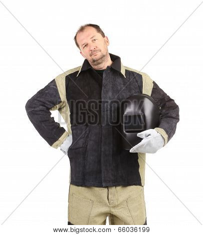 welder man holding welding mask