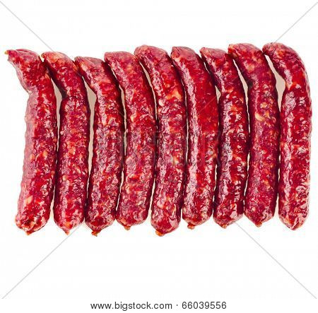 Stack of smoked sausages top view   isolated on white background
