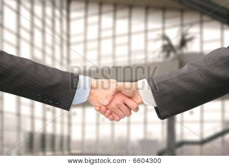 Shaking Hands With Wrists In Hall Of Business Center