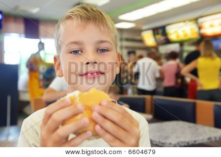 Boy Eats Hamburger