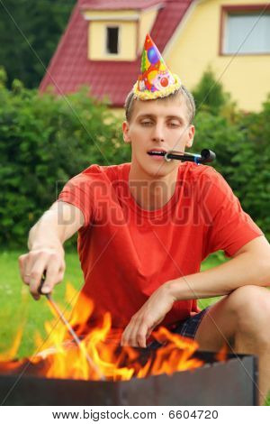 Young Man With Calumet Near Brazier On Picnic, Happy Birthday Party