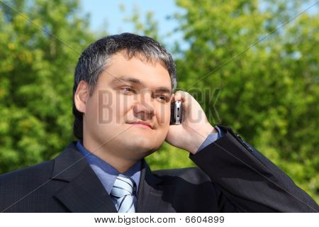 Businessman Speaking By Phone Outdoor In Summer