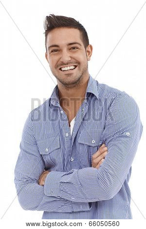 Portrait of confident young man smiling arms crossed.