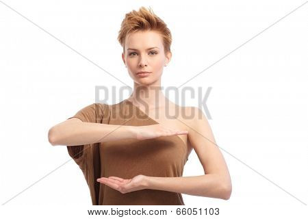 Pretty young girl pretending to hold something in hands over her breasts.