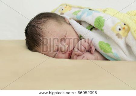 Closeup of newborn baby in blanket