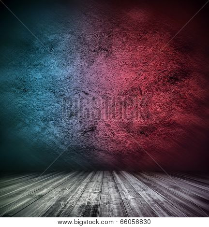 Abstract stonework background texture with old weathered dark stucco blue and red paint stone cement wall in rural room Grungy rock surface in hard grime empty place with wood panel light brown floor