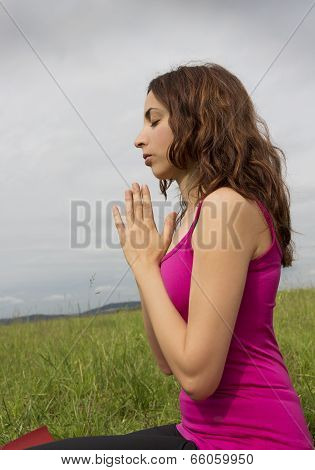 Relaxed Woman Meditating In Nature