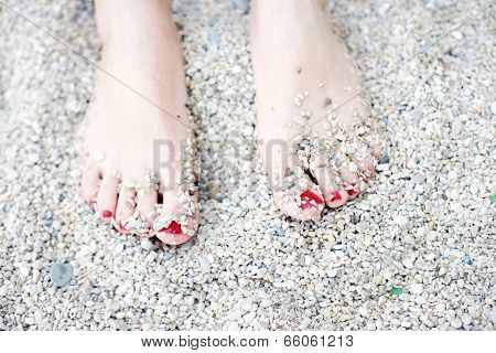 Summer, feet on the beach