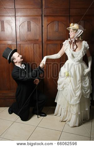 Couple in 19th century garment with woman in dominant role