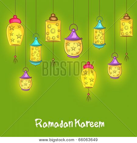 Illuminated hanging lanterns on green background for holy month of Muslim community Ramadan Kareem on green background.