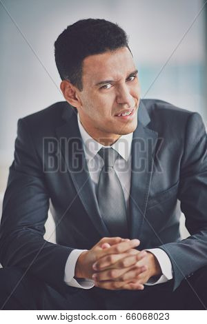 Young businessman in suit showing misunderstanding