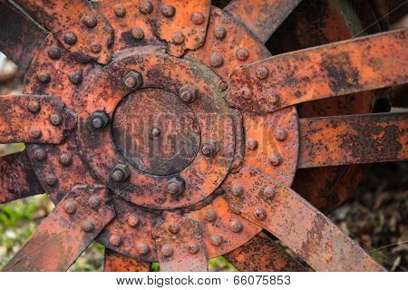 Closeup Photo Of Old Red Rusted Tractor Wheel