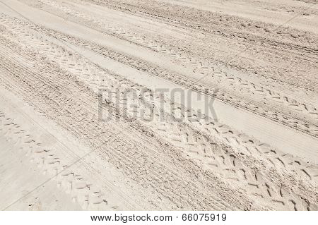 A Lot Of Atv Tracks On The White Sand Beach