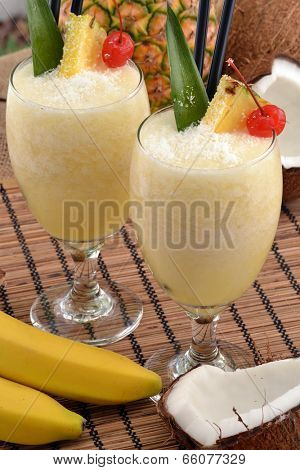 Pina colada cocktail drinks and tropical fruits.