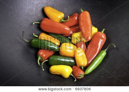 Colorful Peppers In A Cast Iron Pot