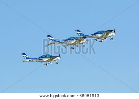 BERLIN, GERMANY - MAY 21, 2014: Aerobatic team 3x Fly Sinthesis Texan Top Class (Wefly team, Italy) demonstration during the International Aerospace Exhibition ILA Berlin Air Show-2014.