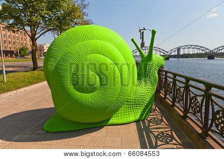 Green Snail On The Street Of Riga, Latvia