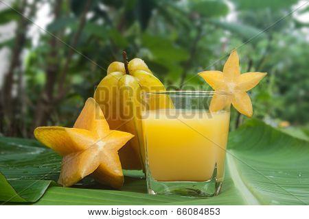 Averrhoa carambola or Starfruit and juice on a banana leaf.