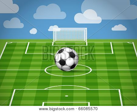 Soccer ball lying on the grass of the game field