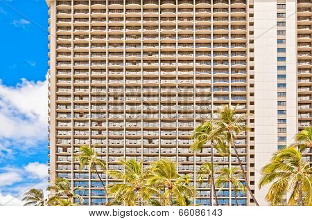 facade of Waikiki hotel with palms in Honolulu