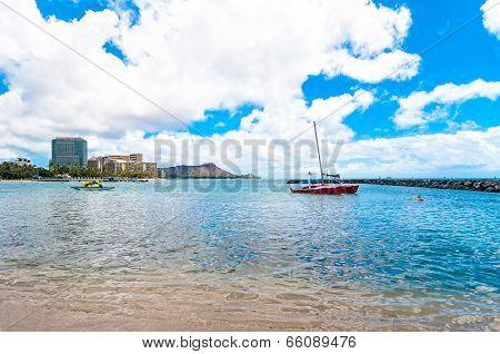 Waikiki shoreline with boat and Diamond Head in Honolulu