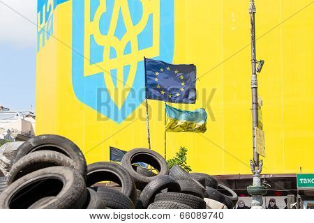Ukrainian And European Flag On The Barricades Of Tires In Kiev