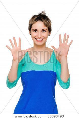 Portrait of happy woman showing ten fingers