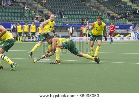 THE HAGUE, NETHERLANDS - JUNE 2: Australian Turner is shooting the ball in the direction of the goal after a corner during the Hockey World Cup 2014. AUS beats SPA 3-0
