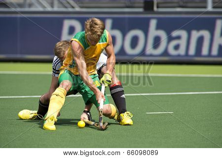 THE HAGUE, NETHERLANDS - JUNE 1: Two unidentified field hockey players fight for possession over the ball during the match between Germany and South Africa at the World Cup Hockey. Germany wins 4-0
