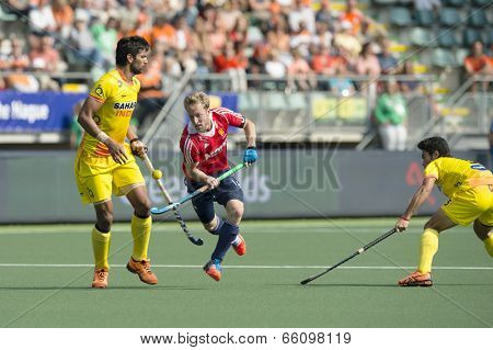 THE HAGUE, NETHERLANDS - JUNE 2: English player Barry Middleton (middle) lifts the ball high on his stick, passing Indian player Rupinder at the Rabobank World Cup Hockey. England Beats India 2-1