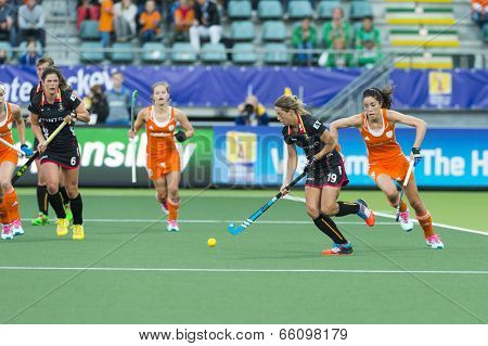 THE HAGUE, NETHERLANDS - JUNE 2: Netherlands beat Belgium at the Rabobank World Cup Hockey in the Kyocera Stadium during the group phase 4-0. Naomi van As (NED) challenges Barbara Nelen (BEL)