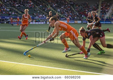 THE HAGUE, NETHERLANDS - JUNE 2: Dutch Jonker is lifting her stick to control the ball, Belgium player de Groof is trying to take over the ball during the Hockey World Cup 2014 NED beats BEL 4-0